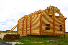 Wooden house from logs, under construction Stock Photos