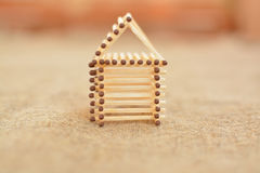 Wooden house made of matches. Handmade. Blurring background. Free place. Concept Stock Photo