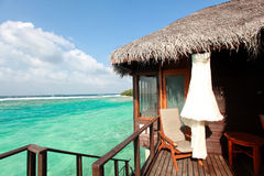 Wooden house maldive resort. Happy days in Maldives, islands with vivid clear sea water, pretty endless beach, soft white sands, luxury water villa, straight Royalty Free Stock Image