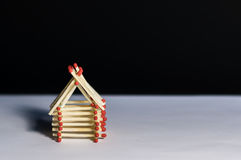 Wooden house from matches - safe living with insurance Royalty Free Stock Photo