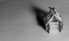 Wooden house from matches - safe living with insurance Stock Image