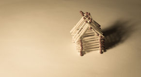Wooden house from matches - safe living with insurance Royalty Free Stock Images