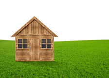 Wooden house in the meadow Stock Images