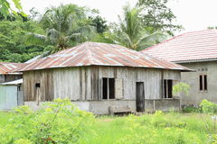 Wooden house with metal roof Royalty Free Stock Photography
