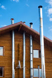 Wooden house with modern chimney Stock Photo