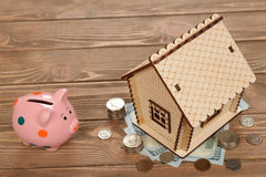 Wooden house and money Royalty Free Stock Photography
