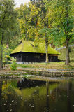 Wooden house with moss on roof Stock Photo