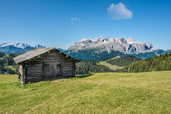 Wooden house in mountain landscape of alto adige, italy. Wooden house in mountain landscape of alto adige, northern italy royalty free stock photo