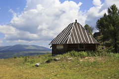 Wooden house on mountain top Tiyahta Royalty Free Stock Photo