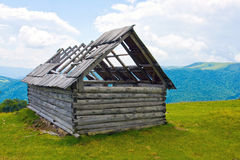 Wooden house in mountains Stock Photo