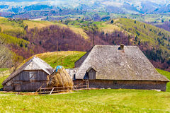 Wooden house and mountains Stock Photos
