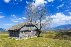 Wooden house and mountains Stock Image