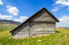 Wooden house and mountains Royalty Free Stock Photo