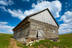 Wooden house and mountains Stock Images