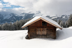 Wooden house in mountains Royalty Free Stock Photo