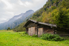 Wooden house in the mountains. Landscape with a wooden house in the mountains royalty free stock photography