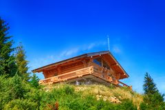 Wooden house in the mountains Stock Image