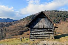 Wooden house in mountains Stock Image