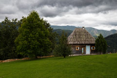 Wooden house in nature Stock Images
