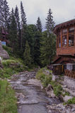 Wooden house near a mountain river Royalty Free Stock Photos