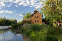 Wooden house near the river Royalty Free Stock Photos