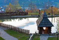 Wooden house near small lake. Stock Images