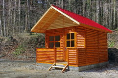 In the forest. Wooden house Stock Images