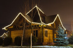 Wooden house at night Stock Image