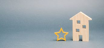 Wooden house and one star. Concept of negative feedback. Low quality and service serving. Evaluation of the critic. Hotel or royalty free stock image