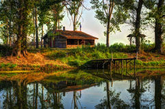 Wooden house on Osam river stock photos
