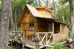 Wooden house in Patagonia. Mountain Refuge in Patagonia - a typical and beautiful wooden Patagonian cabin located in the middle of the forest, where the beds Stock Photo