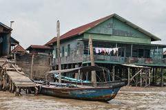 Wooden house on piles in Palembang, Sumatra, Indonesia. Royalty Free Stock Photography
