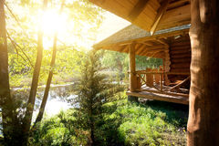 Wooden house and pond Stock Images