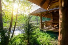 Wooden house and river Stock Photos