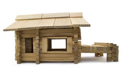 Wooden house profile. Isolated wooden toy home profile view with pier Royalty Free Stock Photography