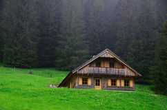 Wooden house and rain Royalty Free Stock Image