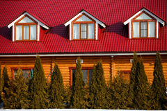 The wooden house with a red roof and windows Stock Images