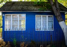 Wooden house for rest with a sauna and the big wooden font stock photography