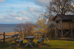 Wooden house and the river Stock Photography