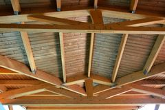 Wooden house roof ceiling detail. Tall wooden roof ceiling structure stock photos