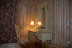 Nice furniture and design of room with wooden walls stock images