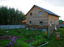 Wooden house for a rural plot in the evening. Russia Stock Photos