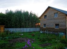 Wooden house for a rural plot in the evening. Russia Stock Photography