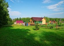 Wooden house for a rural plot in the spring. Russia Royalty Free Stock Photo