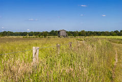 Wooden House. Rural spot - bright day - clear sky Stock Photo