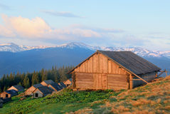 Wooden house of shepherds in mountains Royalty Free Stock Photos
