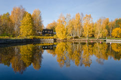 Wooden house on the shore Stock Photos