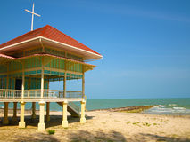 A wooden house side a beach. Royalty Free Stock Photos