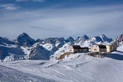 Wooden house in snow mountain Royalty Free Stock Photos