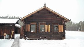 Wooden house in the snow. North on the mountain forests. Picture Idyllic cottage